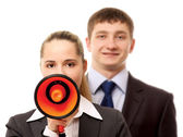 Businesspeople with a loudspeaker — Stock Photo