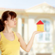 Young woman with little house — Stock Photo