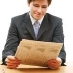 Businessman reading newspaper — Stock Photo #41184121