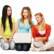 Three girls with a laptop — Stock Photo #41189211