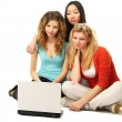 Three girls with a laptop — Stock Photo #41189245