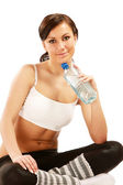 Sportive woman holding a bottle of water — Photo