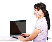 Servizio clienti girl con un auricolare — Foto Stock