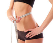 Woman measure her waist — Stockfoto