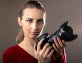 Young woman with camera — Photo