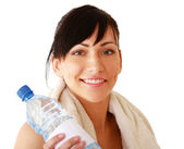 Sport Woman holding bottle of water — Stockfoto