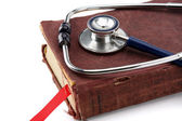 A medical stethoscope over a book — Stock Photo