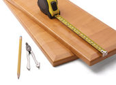 Wooden board and tools — Stock Photo