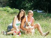 Couple With Their Puppy — Stock Photo