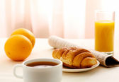 Croissants, Coffee, Orange Juice and Newspapers — Stock Photo