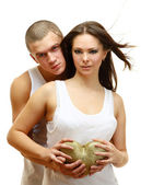 Couple Sexy holding gold heart — Stock Photo