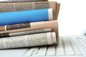 Stack of newspaper  on  laptop — Stockfoto