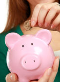 Young woman with piggy bank (money box) — Stock Photo