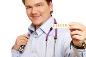 Doctor with piece of paper,word health — Stock Photo