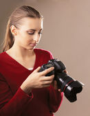 Young woman with camera — Stockfoto