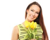 Happy woman with yellow tulips — Stock Photo
