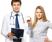 Male doctor showing a card and a patient — Stock Photo