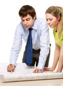 Businesspeople checking a draft — Stockfoto
