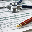 Stethoscope on medical billing statement — Stock Photo #41194089