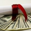 Close-up of dollars and diploma — Stock Photo #41196041