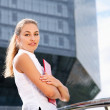 Businesswoman standing near office building — Stock Photo