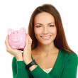 Woman standing with piggy bank (money box) — Stock Photo #41198347