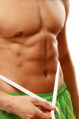 Muscular male torso is being measured — Stock Photo