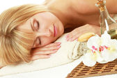 Young blonde woman at spa procedure — Stock Photo