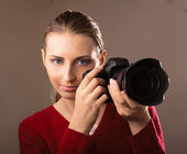 Young woman with camera — Stock Photo