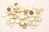 Coins on pink background — Stock Photo
