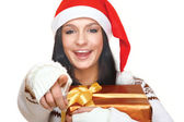 Mrs. Santa with catching a gift box — Stock Photo