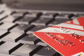 Credit card on keyboard — Stock Photo