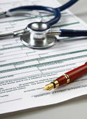 Stethoscope on medical billing statement — Stock Photo