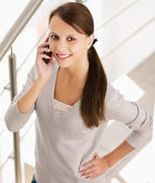 Woman holding a cell phone — Stock Photo