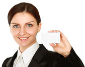 Woman holds out a business or credit card — Stock Photo