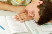 A young guy sleeping on the desk — Stock Photo