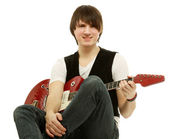 Rocker with his red electric guitar — Stock Photo