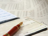 A pile of bills, checkbook, pen — Stock Photo