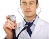 Doctor using his stethoscope — Stock Photo