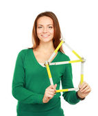 Woman holding a ruler in the form of a house — Foto de Stock