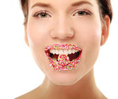 Woman lips with multicolored pearls — Stock Photo