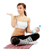 Sportive girl sitting on the floor — Stock Photo