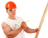 Topless construction worker with wood — Stock Photo