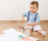 2 year boy covered in bright paint. — Stock Photo
