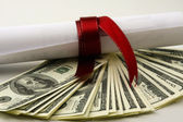 Close-up of dollars and a diploma — Stock Photo