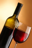A glass of wine and a bottle — Stock Photo