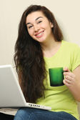 Girl with laptop and holding cup — Foto de Stock