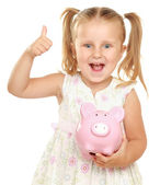 The little girl with a money box — Stock Photo