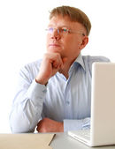 Man sitting in front of a laptop — Stock Photo
