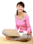 Woman using laptop  and holding cup — Foto Stock